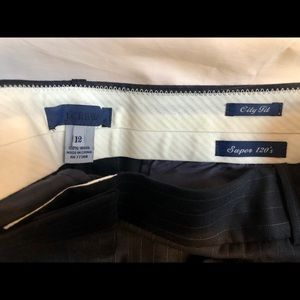 Navy blue pinstriped dressy trousers.